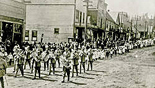 Parade down First Street, early 1900s